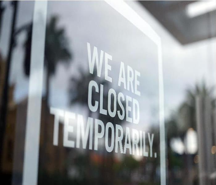 shot of store closed sign